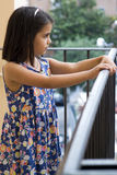 Girl standing on the balcony of home Royalty Free Stock Image