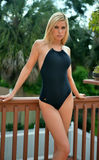 Girl standing on balcony in one piece black swimsuit Stock Image