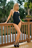 Girl standing on balcony in one piece black swimsuit Royalty Free Stock Images