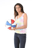 Girl standing with basket ball Stock Photography