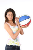Girl standing with basket ball Royalty Free Stock Image