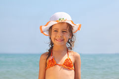 Girl standing on beach royalty free stock photography