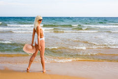 Girl standing on beach Royalty Free Stock Photo