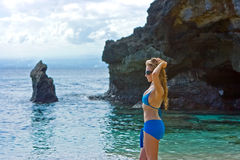 Girl standing on the beach on Bali Stock Images