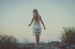 Child with long blond hair and white princess dress Royalty Free Stock Photo