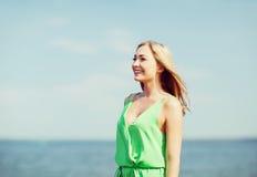 Girl standing on the beach Stock Photo