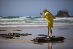 Girl Standing at the Beach Royalty Free Stock Photo