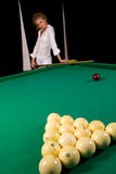 Girl standing behind billiards table Stock Photography