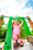 Girl standing with bending knees on the chute Stock Photography