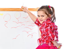 Girl standing at the blackboard, isolated Royalty Free Stock Photos