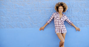 Girl Standing At The Blue Brick Wall Stock Photography
