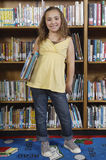 Girl Standing With Books Royalty Free Stock Images