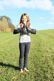 Girl standing with boots on hands Royalty Free Stock Photo