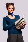 Girl standing with a bunch of books Stock Photography