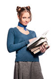 Girl standing with a bunch of books Stock Image