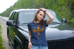 The girl standing by the car Royalty Free Stock Image