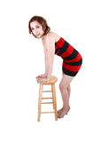 Girl standing with chair. Stock Photography
