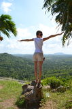 Girl is standing on the chopped tree Stock Images