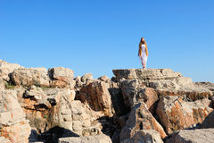 Girl standing on a cliff Royalty Free Stock Photography