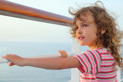 Girl standing on cruise liner deck, hands on rail Royalty Free Stock Image