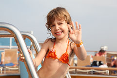 Girl standing on cruise ship, smiling Stock Image