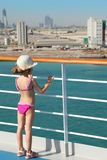 Girl standing on deck of cruise ship Stock Image