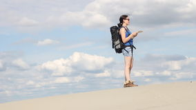 Girl standing in the desert stock footage