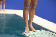 Girl standing on diving board Stock Image