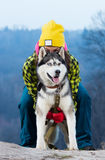 Girl standing with a dog Husky in the mountains. Girl standing with a dog Husky stock photography