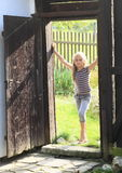 Girl standing in door Royalty Free Stock Image