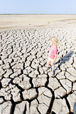Girl standing on dry land Stock Photography
