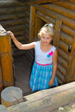 Girl standing at the dugout Royalty Free Stock Photo