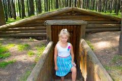 Girl standing at the dugout Stock Photos