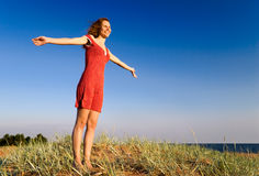 Girl standing on a dune-1. Girl standing on a dune Royalty Free Stock Photo