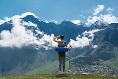 Girl standing edge of cliff and looking at mountain landscape Royalty Free Stock Image