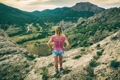 Girl standing on the edge of the cliff Stock Image