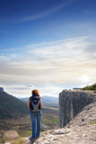 A girl standing on the edge of the high mountain royalty free stock images