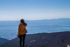 Girl standing on the edge. And looking over a clif royalty free stock photos