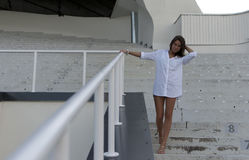 Girl standing in an empty stadium Royalty Free Stock Photography