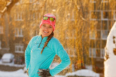 Girl standing in falling snow Stock Photography