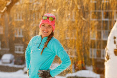 Girl standing in falling snow Royalty Free Stock Photography