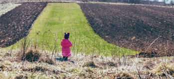 Girl standing in the field. panorama. Royalty Free Stock Photography