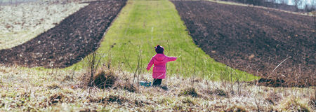 Girl standing in the field. panorama. Stock Photo