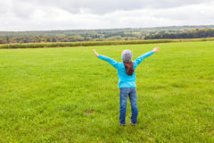 Girl standing in a field Stock Photos