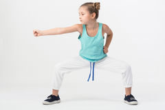 A girl is standing in a fighting with outstretched fist Royalty Free Stock Image