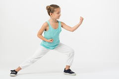 A girl standing in a fighting stance Royalty Free Stock Photo