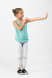 A girl is standing in a fighting stance Royalty Free Stock Images