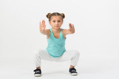 A girl is standing in a fighting stance Royalty Free Stock Photo