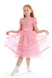 Girl standing on floor in ball dress makin curtsy Royalty Free Stock Photography