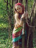 Girl standing in forest Royalty Free Stock Photos